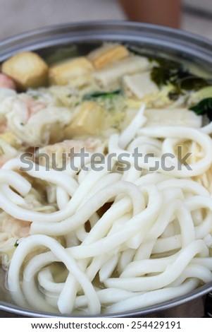 Sukiyaki with udon on the pot - stock photo