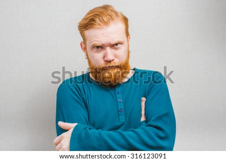 Sulking man crossing his arms - stock photo
