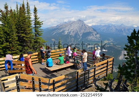 SULPHUR MOUNTAIN, AB- AUGUST 01: Gondola ride to Sulphur Moutain in Banff, Canada on August 01, 2014. Sulphur Mountain top is visited by thousands of tourists every year. - stock photo
