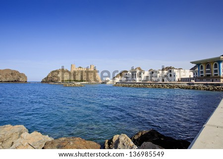Sultan's Palace complex with Al-Jalali fort in Old Muscat, in Old Muscat, Oman - stock photo