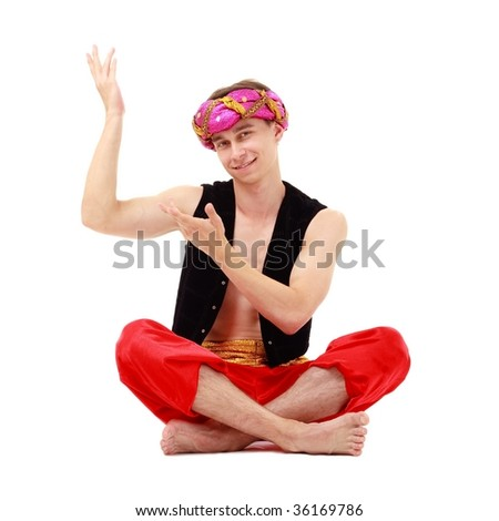 Sultan. Smiling man in turban sitting on a white background. - stock photo