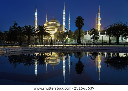 Sultanahmet Mosque (Blue Mosque) reflected in the pool of fountain in early morning, Istanbul, Turkey - stock photo