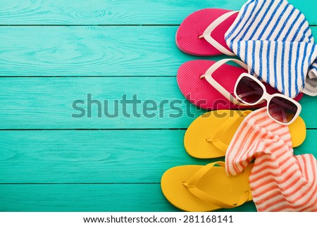 Summer accessories on blue wooden background. - stock photo