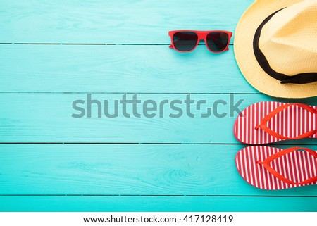 Summer accessories on blue wooden floor. Top view and copy space  - stock photo