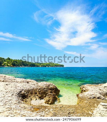 Summer Adriatic Sea Landscape in Croatia with Crystal Clear Azure Water and Rocky Shore. Mediterranean Vacation Concept. Copy Space. - stock photo