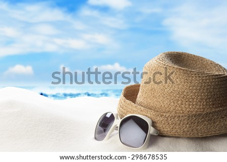 Summer and Beach Concept. Sandy Beach with Sunglasses and Hat - stock photo