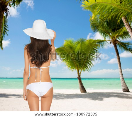 summer and holidays concept - woman posing in white bikini with hat - stock photo