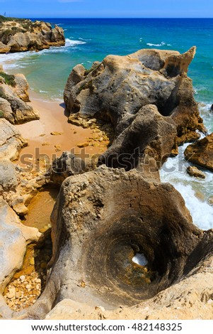 Summer Atlantic rocky coast view (Albufeira outskirts, Algarve, Portugal).