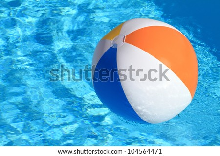 Summer background. Beach Ball on the swimming Pool - stock photo