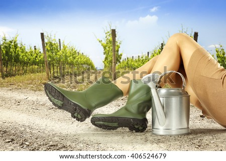 summer background of vineyard and silver can woman legs and sun  - stock photo