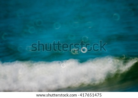 Summer Background / Poster on tropical beach background with sparkling natural bokeh over blue water. - stock photo