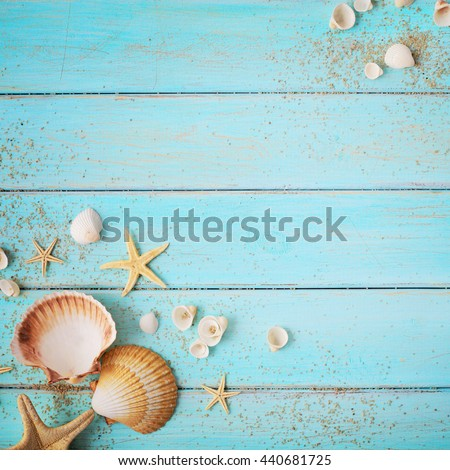 summer background. seashells border on wooden board - stock photo