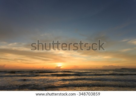 summer background, sunset dramatic sky with colorful cloud on sea - stock photo