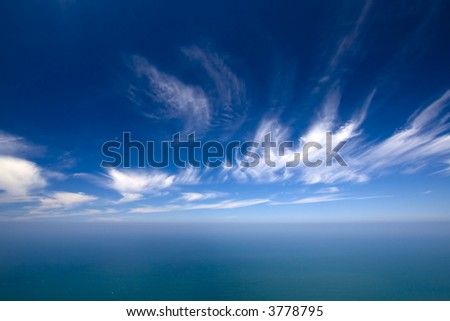 summer background with blue water and sky - stock photo