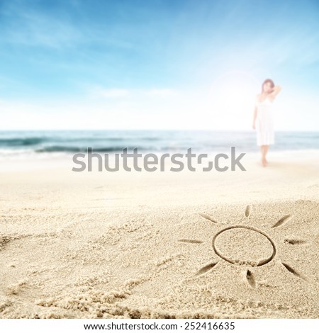summer background with sun mark on sand and woman on beach and sky of blue  - stock photo
