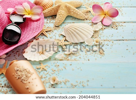 summer background with sunglasses and flip flops on wooden board - stock photo