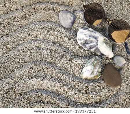 Summer backgrund with sunglasses on a beach sand. Vacation theme with copyspace, Sea shore - stock photo