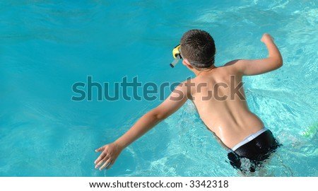 Summer banner with a boy running and jumping into the azure blue water - stock photo