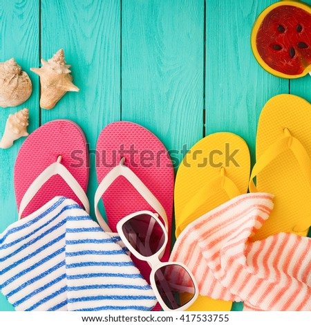 Summer beach accessories on blue wooden floor. Top view and copy space  - stock photo