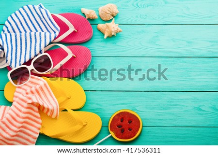 summer wooden table summer beach accessories on blue wooden stock photo 417536311