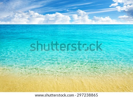 Summer beach background, clear water and blue cloudy sky. - stock photo