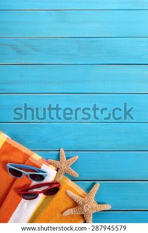 Summer beach couple sunbathing background, sunglasses, copy space, vertical - stock photo