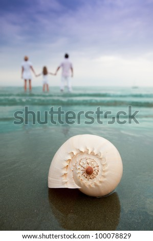 Summer beach - family on summer holiday - stock photo