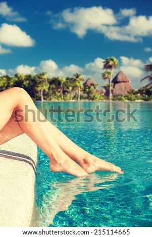 summer, beach, leisure and body part concept - closeup of woman legs at swimming pool - stock photo