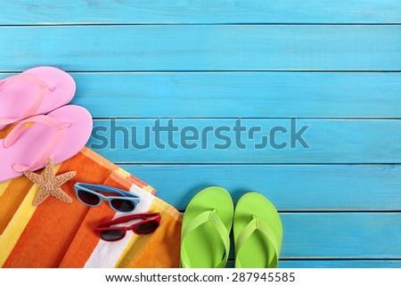 Summer beach sunbathing background, flip flops, sunglasses, copy space - stock photo
