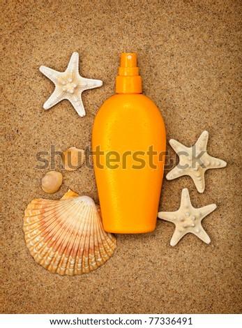 Summer beach - suntan oil - stock photo