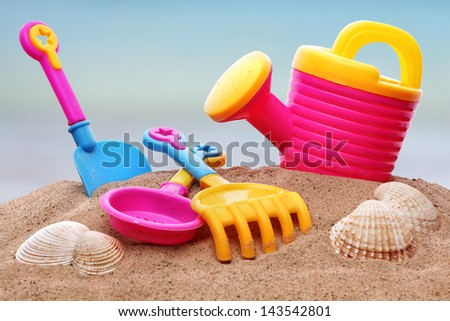 Summer beach toys in the sand - stock photo