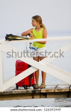 Summer beach, traveler -  lovely girl ready for summer vacation - stock photo
