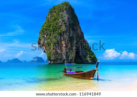 Summer beach tropical landscape. Thailand island scenic background, azure water, traditional long tail boat and rock - stock photo