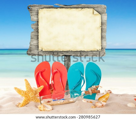 Summer Beach With Colored Sandals And Blank Wooden Poster Blur Azure Sea On Background