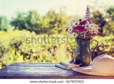 summer beautiful garden with flowers - stock photo