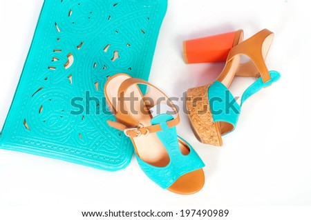 Summer beautiful high heels and handbag on a white background - stock photo