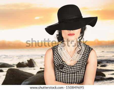 Summer beauty. Portrait of pretty woman wearing old-fashioned dress and floppy hat in sunny warm weather - stock photo