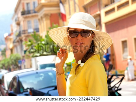 Summer beauty. Shot of a young woman relaxing outdoors while on vacation in luxury France resort. Fresh pretty brunette in sunset light. Travel holidays vacation. - stock photo