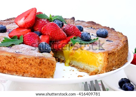 Summer berry fruit tart dessert with lemon curd cream close up selective focus - stock photo