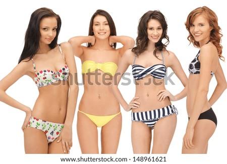 summer, bikini and fashion concept - group of model girls in bikinis - stock photo