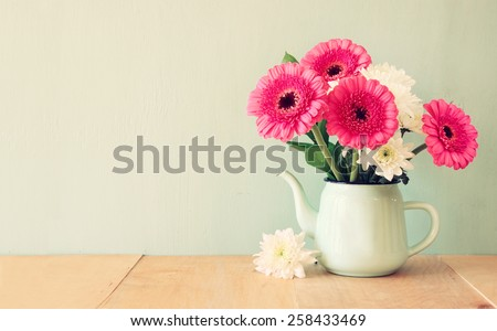 summer  bouquet of flowers on the wooden table with mint background. vintage filtered image - stock photo