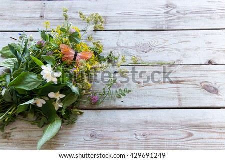 Summer bouquet  on a wooden background