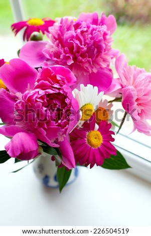 summer bouquet on window-sill - stock photo
