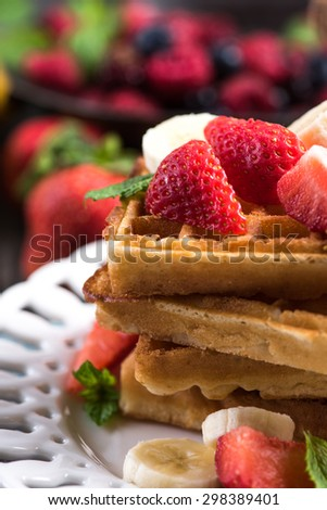 summer breakfast,sweet waffles with strawberry and honey