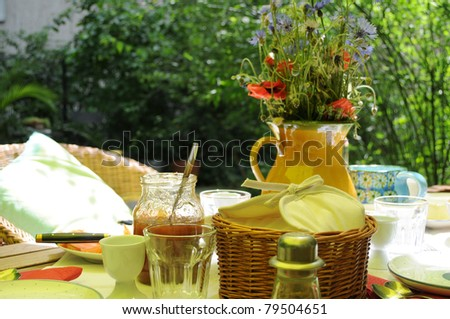 Summer Brunch - Breakfast table on a hot summers day in the shadow - stock photo