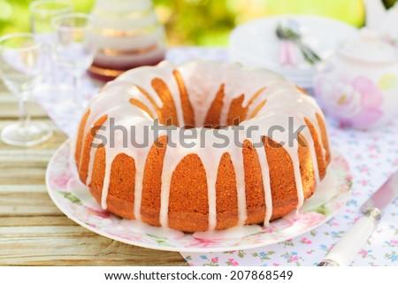 Summer Bundt Cake Topped with Sugar Glaze - stock photo