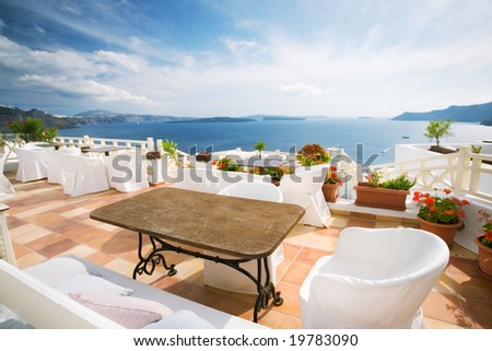 summer cafe at Oia, Santorini island, Greece - stock photo