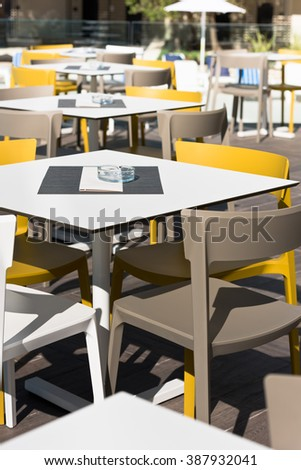 Summer cafe with plastic furniture near swimming pool