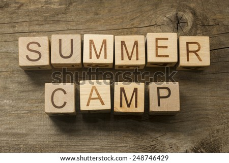 Summer camp text  on a wooden background