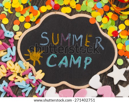 Summer Camp, title on the chalkboard with decoration - stock photo